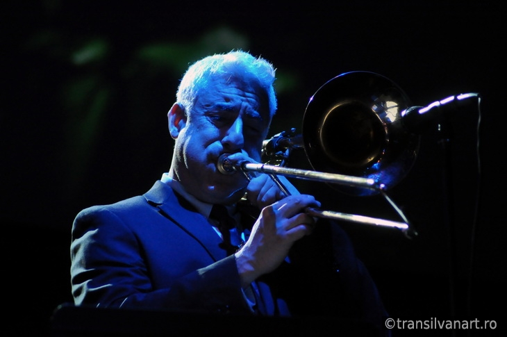 Trombonist from Pink Martini band performs live on the stage