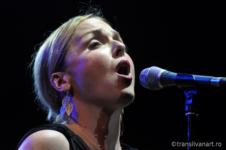 Singer from Pink Martini band performs live on the stage