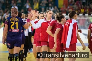Women handball players celebrating victory