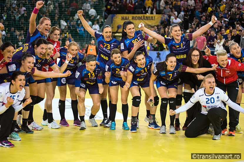 Women handball players celebrating victory